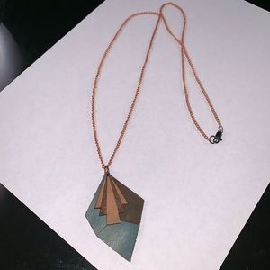 Handmade necklace with leather pendent